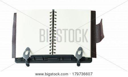 Notebook on portable plastic book stand or book holder isolated on white background