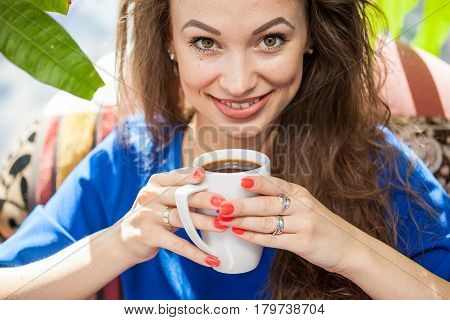 Beautiful woman drinking a cup of coffee. Coffee drinker.