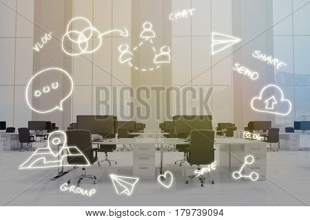 Digitally generated image of computer symbols against office furniture in white room