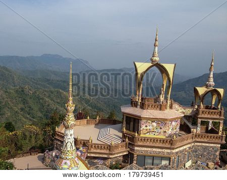 This is a famous place in Phetchabun Thailand. This place name Wat Pha Sorn kaew. A wonderful mountain hill temple with colorful achitecture.