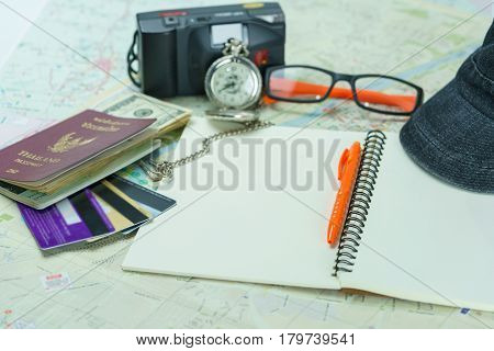 Traveling concept : several items being prepared for a trip