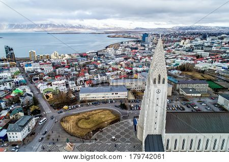 Aerial View Of Famous Hallgrimskirkja Cathedral And The City Of Reykjavik In Iceland.