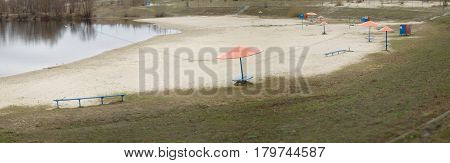 A city beach in the early spring. White sand.
