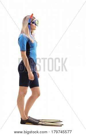 Full length profile shot of a woman with a swimsuit and snorkeling equipment isolated on white background