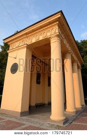 Pavilion in neoclassical style in Moscow Victory Park in Saint Petersburg at sunny summer evening Russia.