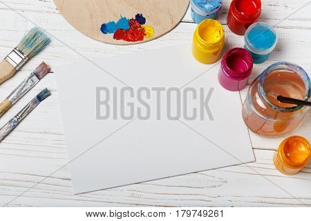 Art and craft tools.Artist's brush, canvas. Wooden art palette with tubes of acrylic paints.Artist's workshop.Art picture with copy space and for add text.Artist workplace background.Paints brushes