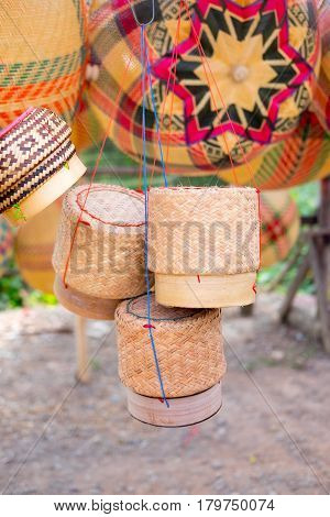 rattan container for keeping glutinous rice hanging in the market