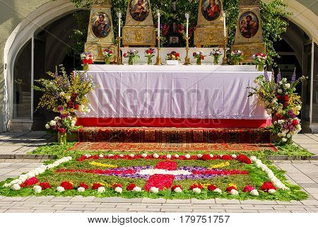 Neuoetting,Germany-May 30,2016: Altar covered with flowers after Corpus Christi services