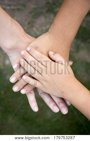 Background of hands of asian female adult and two kids group together for support