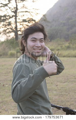 asian younger man toothy smiling face happiness emotion