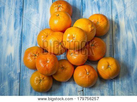 Mandarins on a blue wooden background