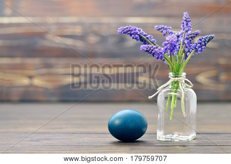 Easter card with blue Easter egg and muscari flowers