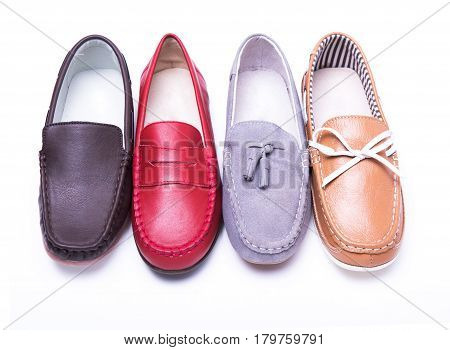 Teen red moccasins on a white isolated background