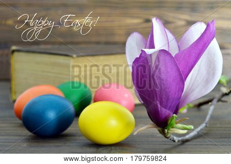 Happy Easter card with Easter eggs and magnolia flowers