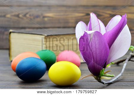 Easter card with Easter eggs and magnolia flowers