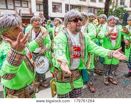 ALGECIRAS SPAIN - MARCH 05 2017: Carnival participants (Chirigota) singing during the parade of the carnival in the street in Algeciras Cadiz Andalusia