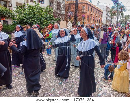 ALGECIRAS SPAIN - MARCH 05 2017: Carnival participants singing and dancing during the parade of the carnival in the street in Algeciras Cadiz Andalusia