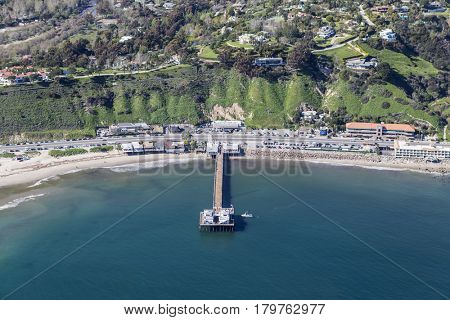 Aerial of Malibu Pier State Park and Pacific Coast Highway near Los Angeles California.