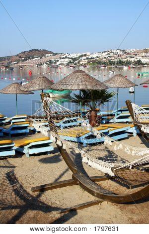 Turkey resort. Morning in beach. Hammocks in beach poster