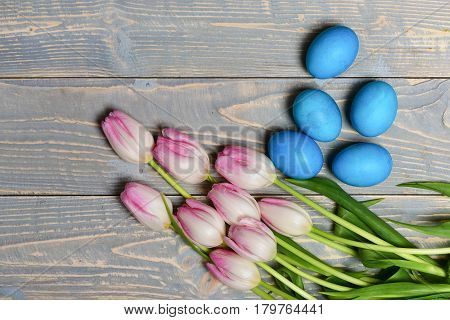 Traditional Eggs Painted In Blue Color With Pink Beautiful Tulips
