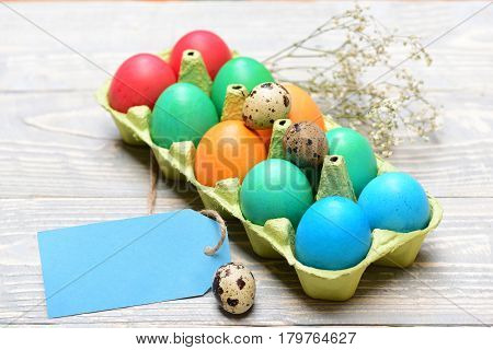 Traditional Eggs Painted In Bright Color Inside Carton Box