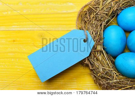 Traditional Eggs Painted In Blue Color Inside Woven Straw Wreath