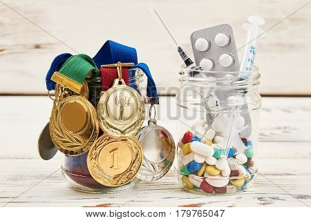 Syringes, medals and pills. Improvement of sports results.