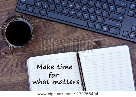 Inspirational quote. Make time for what matters on notebook