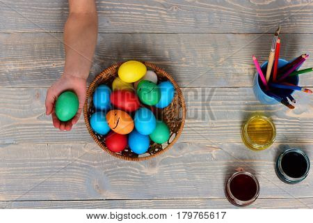 Hands Of Little Small Baby Girl Holding Colorful Handmade Egg