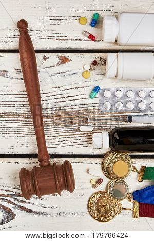 Judge's hammer and drugs. Doping and punishment in sport.