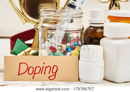 Pill containers and card. Doping is unfair game.