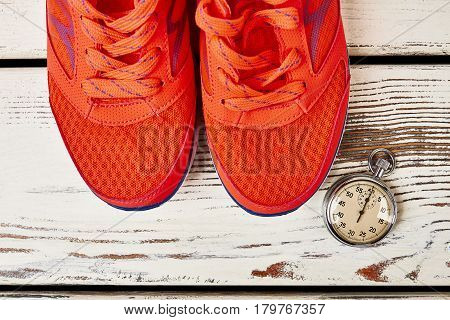 Sport shoes and stopwatch. How to lose weight walking.