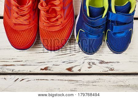 Two pairs of sport shoes. Let's get healthy together.