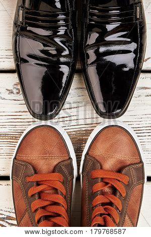 Patent-leather shoes and gumshoes. Men's footwear for walking.