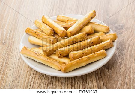 Bread Sticks With Salt In White Saucer On Table
