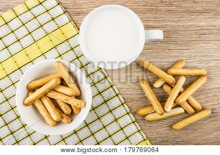 Bread Sticks With Salt, Cup Of Milk And Checkered Napkin