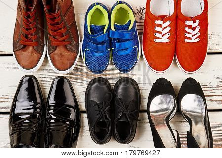 Formal shoes and sneakers. Family set of footwear.