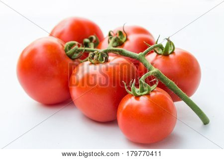 Close up red cherry tomato on white background isolated.