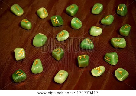 Green stone runes on the red background. Esoteric subjects.