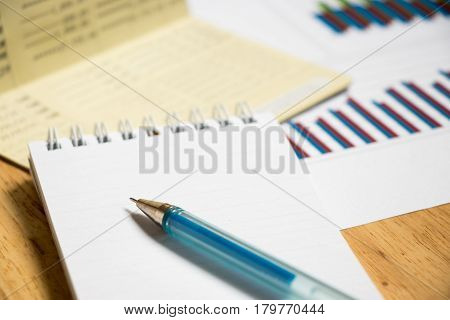 Background of passbook note book with pen and financial graph