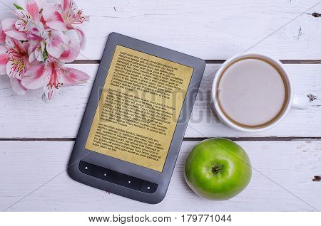 E-book And A Cup Of Coffee On A Wooden Table.