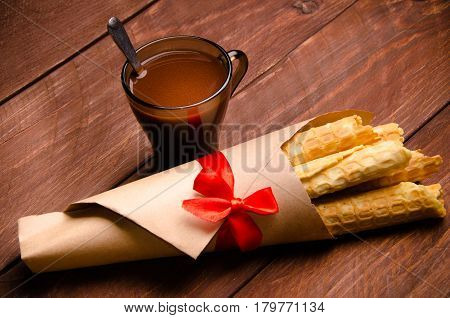 tubular wafer. waffles on wooden boards. a bouquet of waffles
