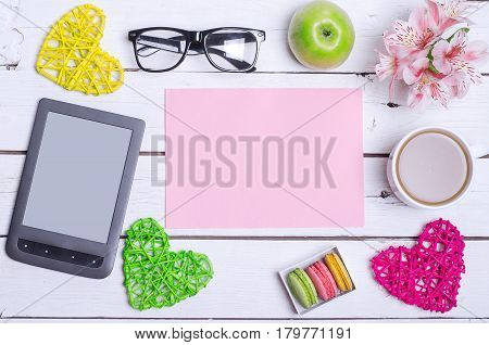 Tablet, Glasses And A Cup Of Hot Coffee On A Wooden Table.