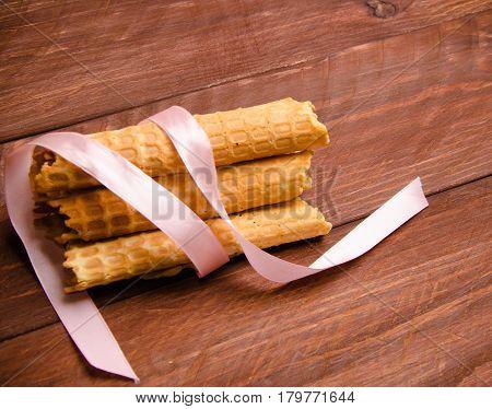 Tubular Wafer. Waffles On Wooden Boards