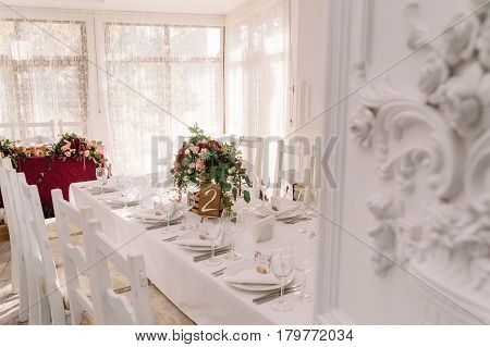 Wedding table decoration of the restaurant in white colors