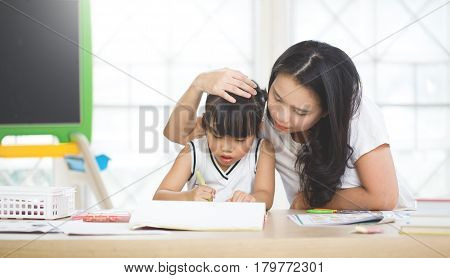 happy family education concept - mother and daughter with chalk drawing
