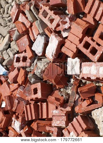 A pile of bricks for recycling in an old brickyard no longer working.