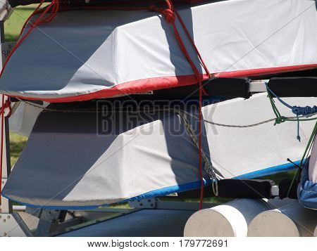 Skiffs and various sailing equipment arrives at a marina for a weekend regatta.