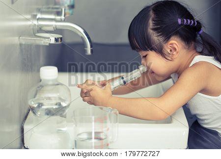 A sick asia children Saline nasal wash
