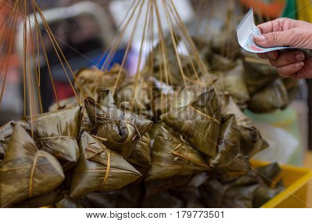 Siew Bak Chang, Glutinous Rice And Pork Wrapped In Banana Leaf Parcels For Sale.